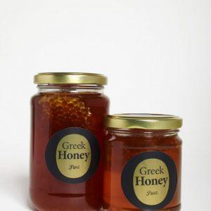Miel Grec de pin avec morceau de rayon de miel